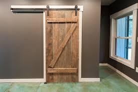 broom closet with barn door eclectic closet