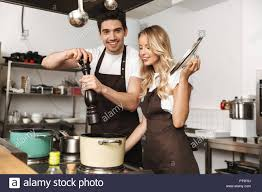 Couple in action in the kitchen