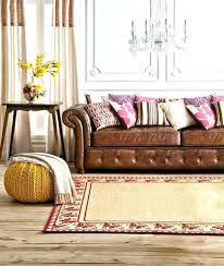 reddish brown leather sofa red brown leather sofa tan chesterfield pink cushions yellow knitted pouf cream reddish brown leather sofa every red