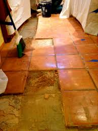 removal of aging and damaged saltillo tile to refresh the floors prior to installation of new