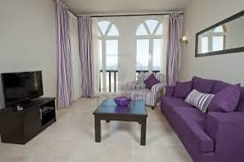 simple living room apartment decoration purple sofa and chusion long light purple curtains off white