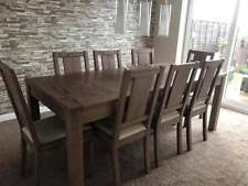 brand new harveys solid dark oak wood extendable dining table and 4 chairs