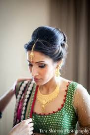 indian wedding bride getting ready hair makeup photo 10979