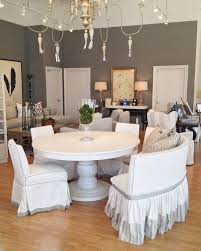 white chairs cover ideas and round dining table furniture for elegant dining room with grey wall paint color also using wooden floor design