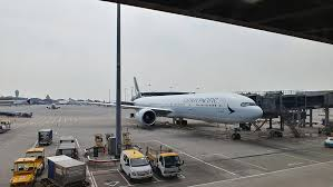 cathay pacific has rolled out a new economy cl seat that is curly being retroed across its fleet of boeing 777 aircraft as the airline
