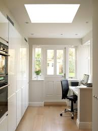 kitchen cabinets home office transitional: front door storage ideas home office transitional with pony wall recessed lights built in kitchen cabinets