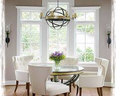 elegant grey wall paint color dining room with antique pendant light above gl round table and white leather chairs also using wood flooring design ideas