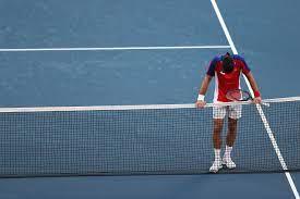 Novak Djokovic smashes and throws ...