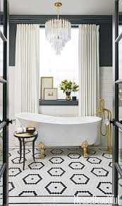 an art deco bathroom in graphite grey and cream and a large crystal chandelier
