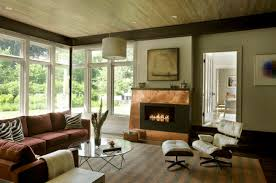 living room with copper fireplace surround
