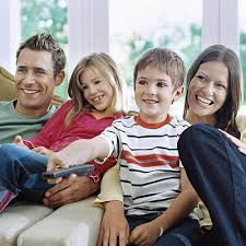 kids watching tv at night. family movie night, parents and children watching tv, little boy with remote control, kids tv at night