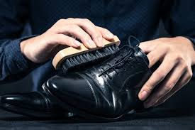 the first commercially produced shoe polish was made of tallow oil wax and soda ash and was initially invented to waterproof and soften leather