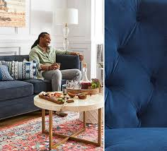 man sitting on blue sofa in a living room