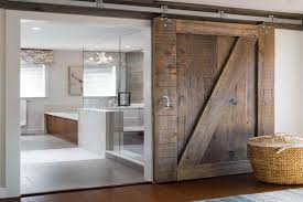 Appealing Barn Door For Bathroom and Bathroom Barn Door Reused Old Barn Door  Creates A Fabulous