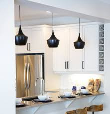 black kitchen lighting. The Black Light Fixtures Make A Great Visual When Paired With White Cabinets And Metallic Appliances. Photo Credit: Houzz. Kitchen Lighting O