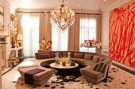 beautiful room decor ideas for apartments with rounded shape sectional brown sofa also crystal chandelier over circled table designs