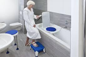 a woman using a disabled bath