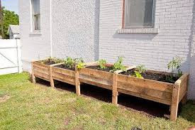 this incredibly easy diy pallet container raised garden bed looks chic and is just right for