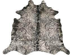 handmade cowhide rug metallic zebra gold on black hides by ebru