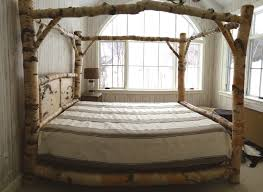 Wood King Canopy Bed | Home design ideas