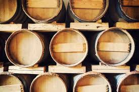 stacked oak barrels maturing red wine. Stacked Oak Barrels Maturing Red Wine. In A Wine Cellar Photo B