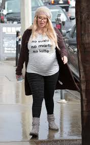 Pregnant Jenna Jameson looks unrecognisable from porn star heyday.