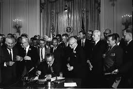 martin luther king jr president johnson signs the civil rights act of 1964 among the guests behind him is martin luther king