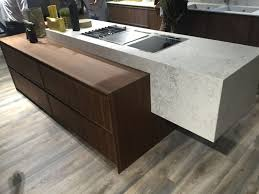 floating marble island mixed with a lower countertop