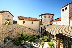 amazing spanish style luxury homes designed by beige stone wall and brown roof tile connected by