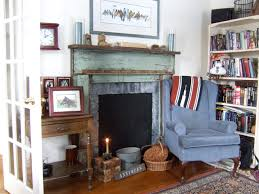 cottage chic living room library photo in other with white walls and a standard fireplace