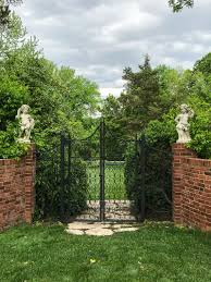 a gate adds an element of intrigue what s behind there while at the same time serving as an opportunity to inject another design note into a garden plan