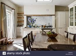 Limestone Flooring In Kitchen Antique Dining Table With Chairs In Open Plan Kitchen Dining Room