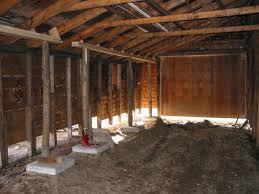 inside barn background. this frame shows the inside of shed on barn in 2002. corner background is south-western shed. l