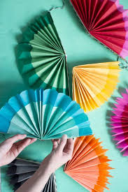 bold and festive fiesta paper fan decorations is what your cinco de mayo party deserves this set of fiesta hanging paper fans contains an assortme