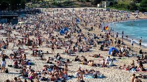 Sydney weather warms as thousands flock to Bondi, Coogee beaches