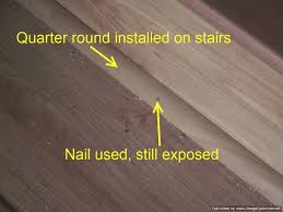 Bad Laminate Stair Installation. It Had Quarter Round Installed On Them To  Hide The Uneven