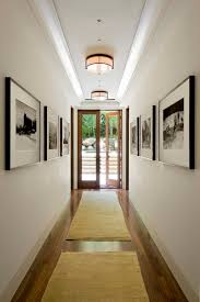 hallway ceiling lights hall transitional with area rug art art baseboard lighting