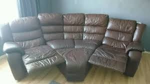 dfs brown leather curved 4 seater recliner sofa with footstool in
