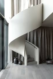 Just loving everything about this space. The spiral stairs, the soft grey  floors, the detailing of the floor vent.