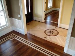 combination of stained and natural flooring with an inlaid medallion and painted borders pinnacle floors 2018 02 05t17 18 38 05 00