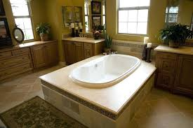 light over bathtub white oval soaking tub in this bathroom sits at center of enormous tile