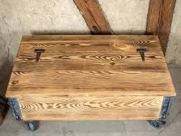 The best kind of furniture is the kind that's as handsome as it is practical. Loft Style Vintage Wood Rustic Coffee Table With Storage Trunk On Casters Factory Cart Table On