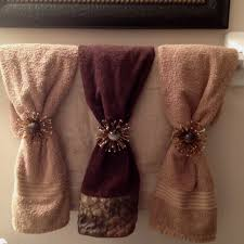 Folded hanging towel Towels Decoratively Hanging Bathroom Towels Decoratively Mywebvaluenet How To Fold Bathroom Towels For Hanging My Web Value