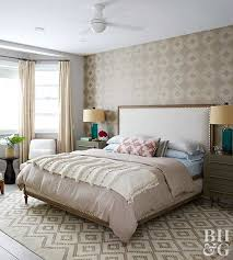 Greige doesn't have to just be a plain wall color -- this bedroom uses two  bold greige patterns to give the room a vibrant feel. The large patterns of  the ...