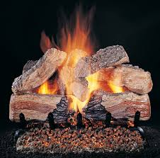 fireplace with vented gas log burner and log set with glowing embers