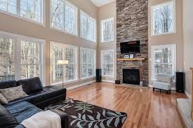 Contemporary Living Room with stone fireplace, High ceiling, Silver  Travertine Stacked Stone Ledger Panels