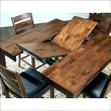 circular expanding table expandable round dining room extending seats free extendable plans tabl table partial open exploded expanding circular