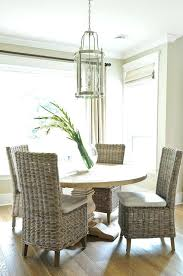 round salvaged wood dining table with wicker chairs transitional room set casters