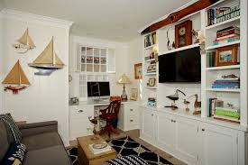 beach style home office coastal home office photo in san diego with white walls light hardwood beautiful home office view