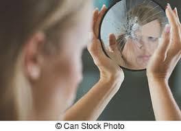 Woman touching broken mirror Beautiful woman with mental stock